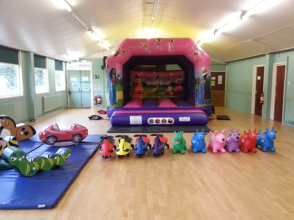 Hall for party with bouncy castle and toys